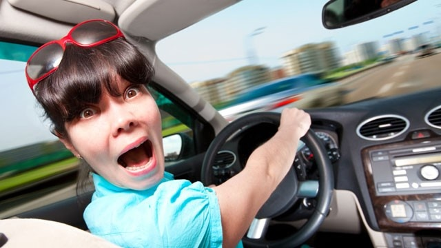 Driver-excuses---scared-woman-driving-car